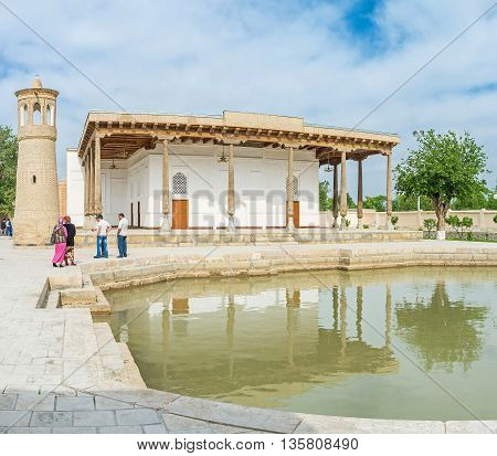 BUKHARA UZBEKISTAN - APRIL 29 2015: The Khakim Kushbegi Mosque boasts its own pool the medieval sign of wealth that was used for the ritual ablutions on April 29 in Bukhara.