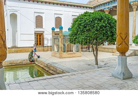 BUKHARA UZBEKISTAN - APRIL 29 2015: The tiny arched saqqakhana drinking fountain decorated with islamic patterns on colorful glazed tiles on April 29 in Bukhara.