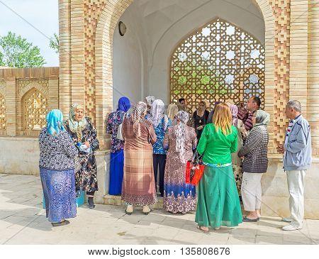 BUKHARA UZBEKISTAN - APRIL 29 2015: The common prayer in the summer pavilion of Bahauddin Nakshbandi complex on April 29 in Bukhara.