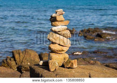 Rock stack over the seacoast, natural landscape background