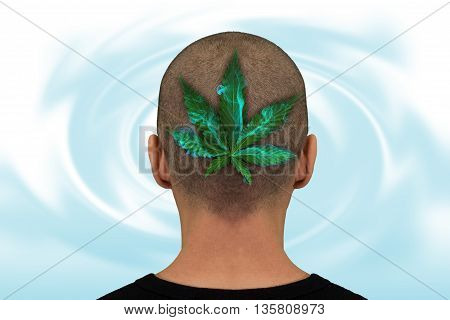 Nape of the neck of a man with a marijuana leaf