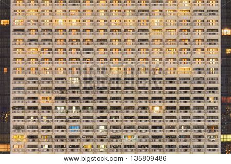 Hotel balcony close up, urban residential building front view, night lights