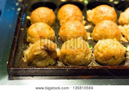selective focus Cooking of Takoyaki one of the most popular food for background