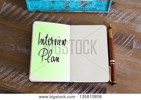 Handwritten Text Interview Plan over notebook, copy space available