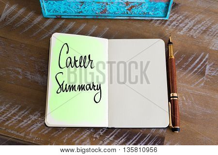 Handwritten Text Career Summary over notebook, copy space available