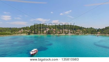 Proizd beach near dalmatian Island of Korcula ,Croatia.Beautiful peaceful island with crystal clear sea full of wildlife.Active summer diving location. Aerial view on  beach and stationary