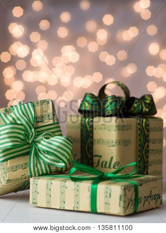 Christmas presents green style. Christmas design gifts and decorations.