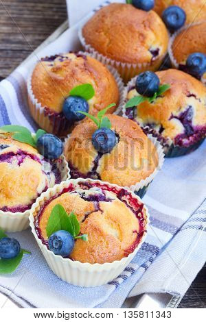 baked cupcakes with fresh blueberry berry and leaves
