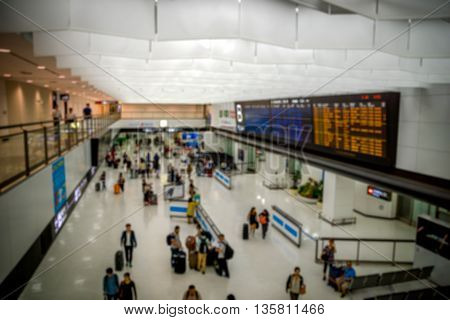 Passengers at airport arrival gate waiting and leaving - blurred