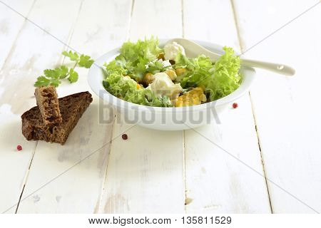 Salad with corn greens feta with mayonnaise sauce