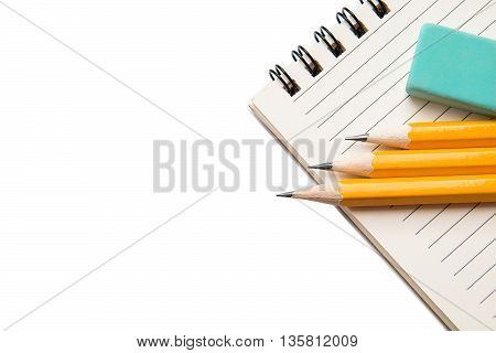 Notepad and pencils on a white background