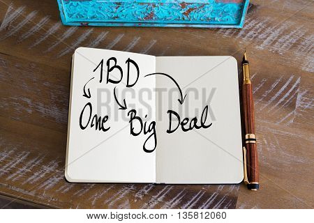 Business Acronym 1BD as One Big Deal handwritten on notebook