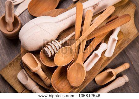 some wooden kitchen utensil in studio on wooden background