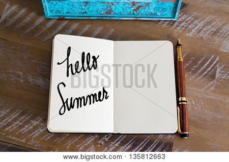 Text Hello Summer over notebook, copy space available