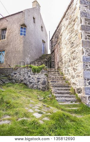 Traditional buildings and stone stairways of a Scottish fishing village