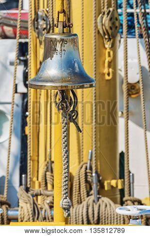 brass ship's bell aboard a sailing ship
