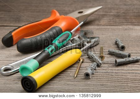 Set of building tools and materials on the wooden background