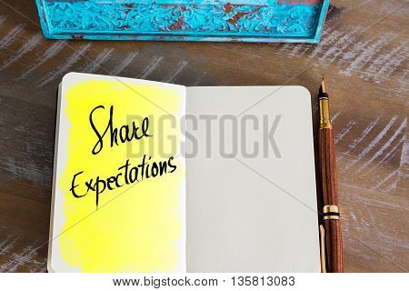 Text Share Expectations handwritten over notebook, copy space available
