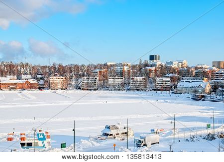 LAPPEENRANTA, FINLAND - FEBRUARY 18, 2010: Winter landscape with boats in Lappeenranta Harbor on Saima Lake. View from Linnoitus Fortress.