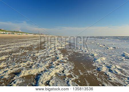 Sea foam on the beach of the North Sea.