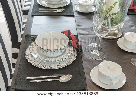 Table Set On Wooden Table In Luxury Dining Room