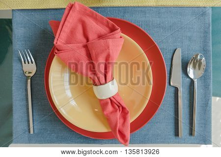 Table Set On Dining Table In Colorful Dining Room