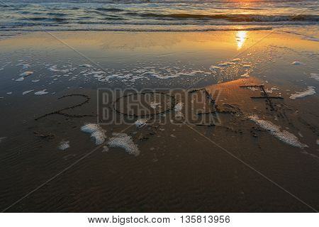 The year 2017 inscribed on the beach during sunset