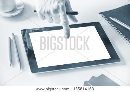 Man's hand using tablet pc with white screen in office