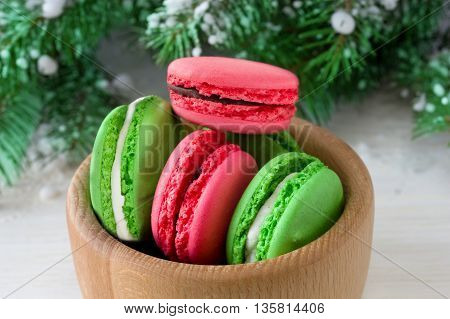 Colorful French Macarons in a wooden bowl. Christmas concept.