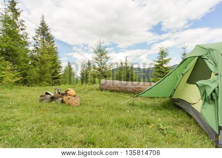 Camping in the mountains with the collected mushrooms and cooking facilities.