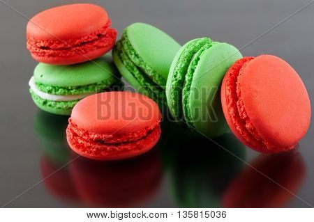 Colorful French Macarons on a dark background. Christmas concept.