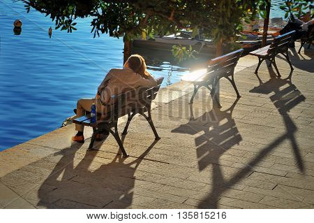 Camogli, Ligure, Italy - 30 October 2015: older couple on a bench by the sea in feelings of love.