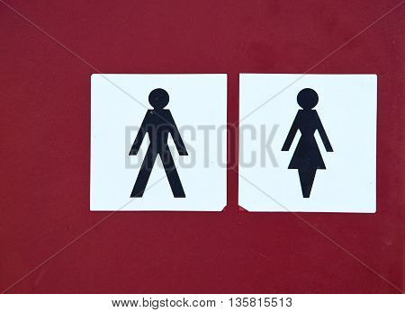 Toilet symbol sign on for men and women on red background