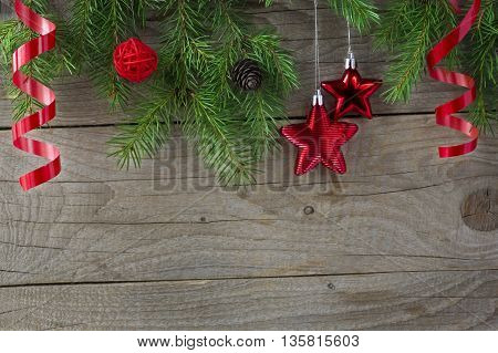 Christmas tree sprigs on wooden background. Winter holidays background