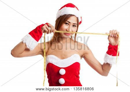 Asian Christmas Girl In Santa Claus Clothes Diet With  Measuring Tape