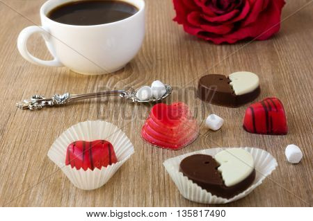 coffee and chocolate candies in a heart shape