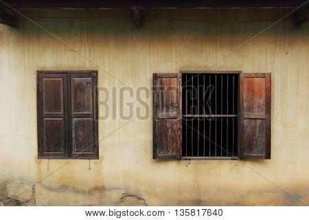 Old wooden windows open on a house wall in Chiang Mai,Thailand