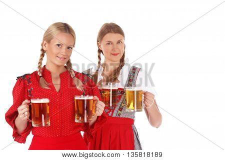 Pretty oktoberfest blonde women holding beer bugs in bar
