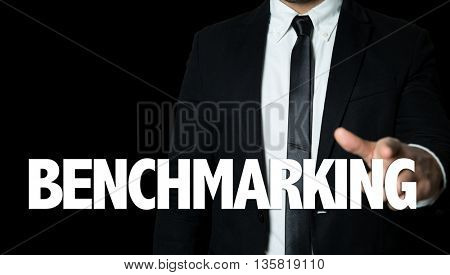 Business man pointing the text: Benchmarking