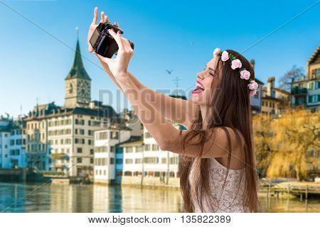 Young brunette girl taking selfie photo in Zurich, Switzerland