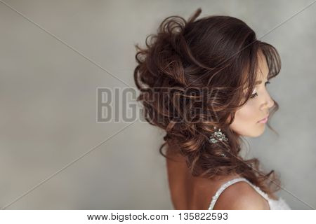 Portrait Of Beautiful Bride With Perfect Makeup And Hairstyle.