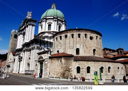 Brescia, Italy - May 30, 2006: The Rotondo (Winter Cathedral /Duomo) of Santa Maria Maggiore dating to the 11th century (on right) and the 16-1th century Duomo Nuovo (new cathedral) at left