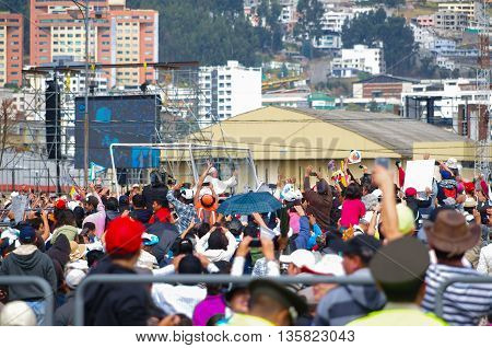 QUITO, ECUADOR - JULY 7, 2015: People trying to say hello to pope Francisco on Ecuador, huge mass.