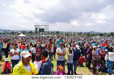 QUITO, ECUADOR - JULY 7, 2015: At pope Francisco mass on Ecuador, people waitting him to attend to mass, colorfull clothes.
