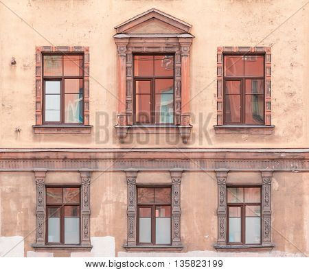 Several windows in a row on facade of St. Petersburg Medical Center front view Russia