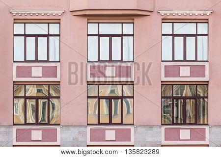 Several windows in a row on facade of Medical center
