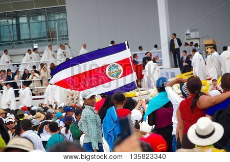 QUITO, ECUADOR - JULY 7, 2015: People waitting for pope Francisco mass, Costa Rica persons on Quito. First visit to Ecuador.