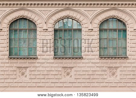Several windows in a row on facade of film studio building front view St. Petersburg Russia