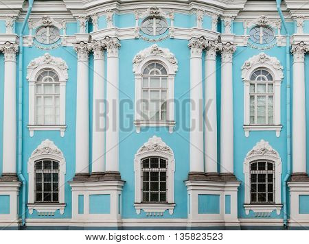 Several windows and columns in a row on facade of of St. Nicholas Naval Cathedral front view St. Petersburg Russia
