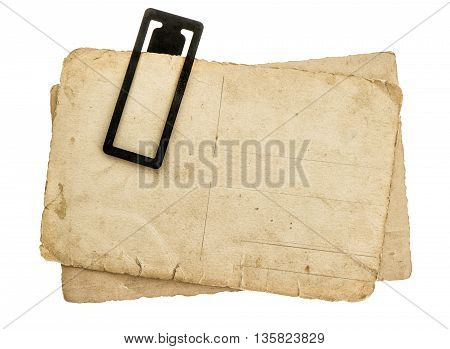Vintage paper sheets with clip. Retro design. Pile of old isolated on white background